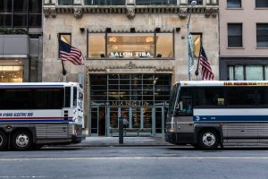 Magnia Restaurant Flanked by Two Buses