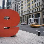 Taxis Speed Past the giant 'e' on 57th Street, New York City