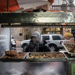 A street seller in New York prepares to launch a tirade of abuse as I take a photo