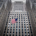 The American Flag Flies Proudly outside one of New York City's Many Skyscrapers